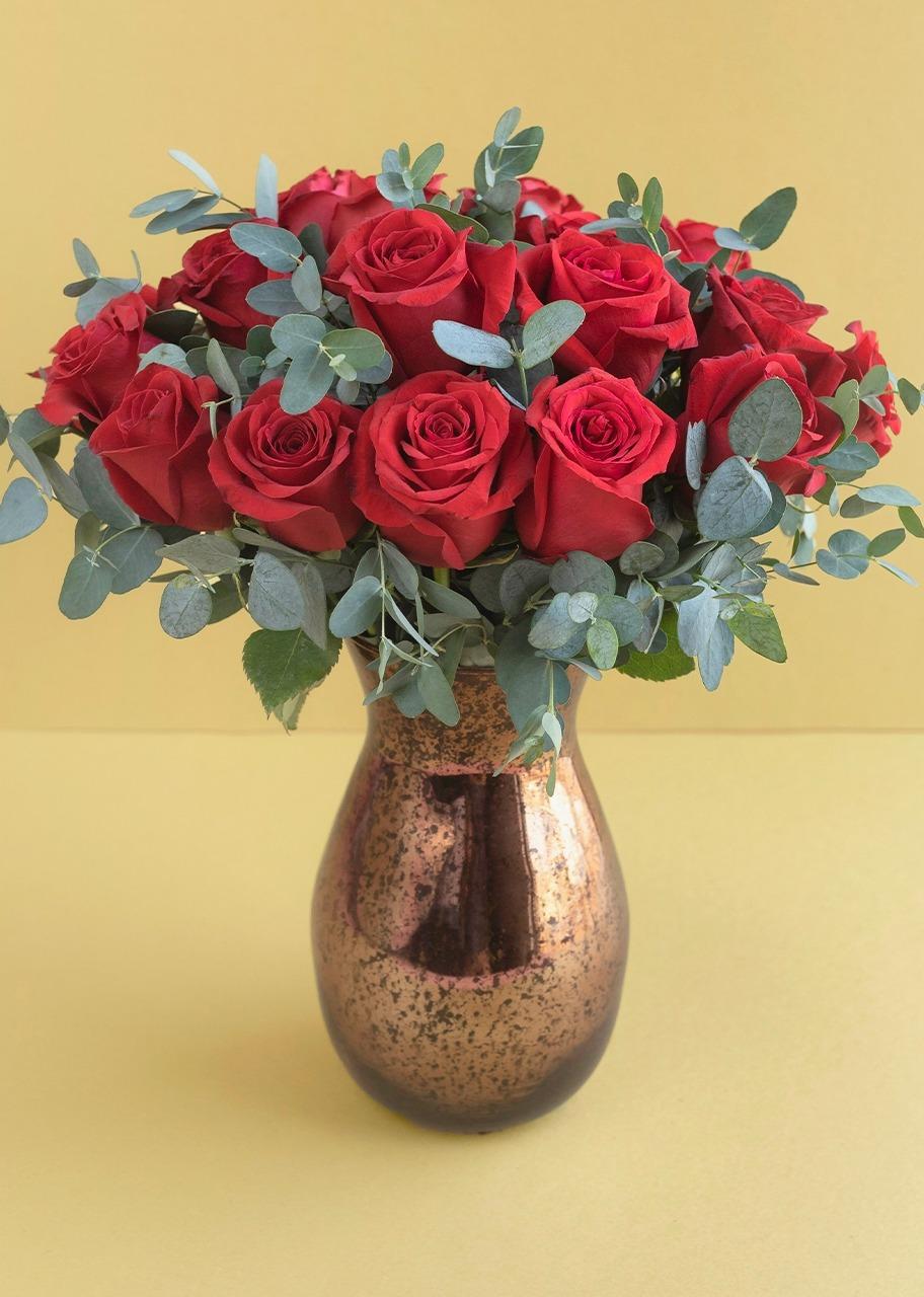 Imagen para Rosas rojas en jarrón jaspeado - 1